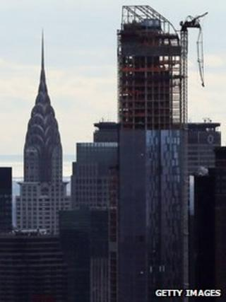 Part of a crane damaged by storm Sandy hangs loose in the New York skyline