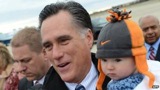Mitt Romney with a supporter's baby in Newington, New Hampshire, on 3/11/12