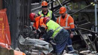 Rescue staff removing debris at the Pike River mine in New Zealand, 28 June 2011