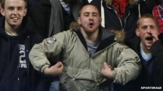 Fan in alleged racist gesture