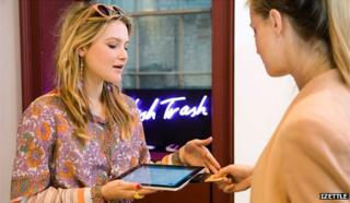 Jewellery maker taking payment on her tablet computer