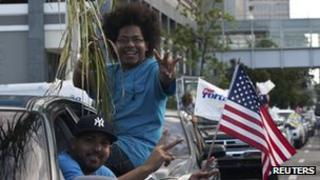 Two Puerto Ricans celebrate after casting their vote on Tuesday