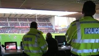 Police officers watching a football game