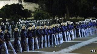 Greek riot police line up in front of parliament