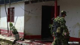 A Colombian soldier arrives at the scene of the killing in Antioquia province