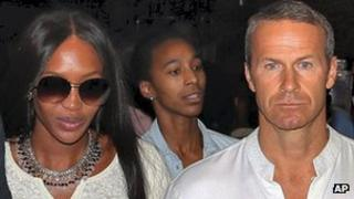 Supermodel Naomi Campbell walks with her boyfriend Russian billionaire Vladimir Doronin as they leave his birthday bash in Rajasthan.