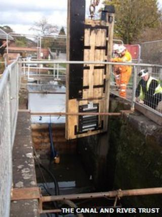 The new lock gates being lowered into place