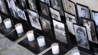 Candles and memorial pictures