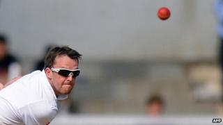 England cricketer Graeme Swann bowls on the first day of a three-day practice match between India A and England at the Cricket Club of India (CCI) grounds in Mumbai on October 30, 2012