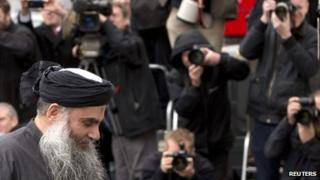 Abu Qatada arrives back at his home in London