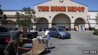 Customers loading up their vehicle after shopping at a Home Depot branch