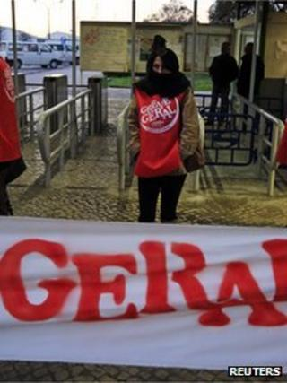 A worker stands at a picket line at Mitrena shipyard, south of Lisbon