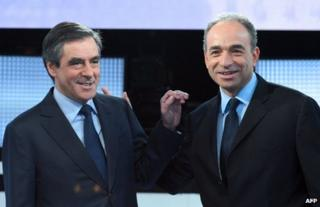 Francois Fillon (left) and Jean-Francois Cope at a televised debate in Paris, 25 October