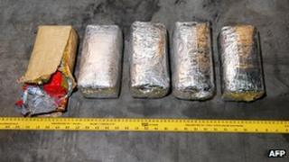 This handout photograph made available on November 16, 2012 by the Australian Federal Police (AFP) shows packages of illegal drugs found and seized on a yacht in Tonga.