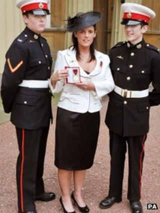 Gillian Molyneux with her sons Jamie and Aaron (right),