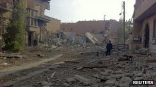 Damaged buildings in the city of Deir al-Zour, 13 November 2012