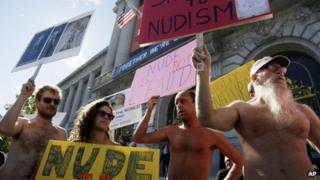 Demonstrators gather at a protest against a proposed nudity ban outside of City Hall in San Francisco, 14 November 2012