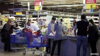 Shoppers at a supermarket in Tunis, 12 November 2012