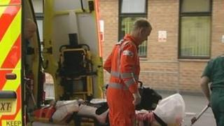 Patient being taken from ambulance