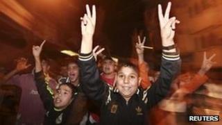 Palestinian boys celebrate the ceasefire, Gaza City (21 Nov)