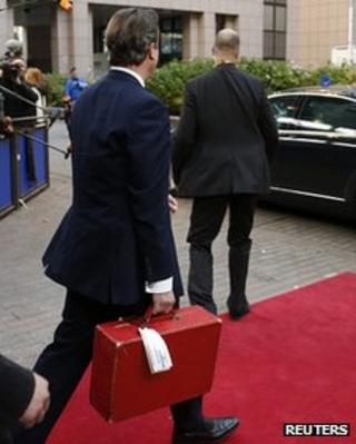 David Cameron carrying a ministerial red box in Brussels