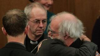 Rowan Williams and his successor Justin Welby after the synod rejected the women bishops measure.
