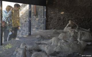 Casts of victims of the volcanic eruption on display in Pompeii