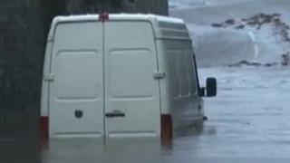 A van stuck in floodwater at Llanrug