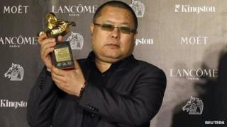 Chinese director Gao Qunshu celebrates winning the Best Feature Film for Beijing Blues