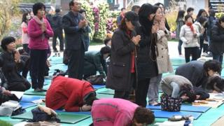 Praying for exam results in South Korea