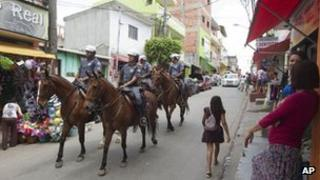 Police patrol in the Paraisopolis slum in Sao Paulo, Brazil, 19 November 2012