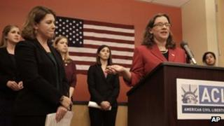 ACLU lawyer Ariela Migdal speaks during a press conference with plaintiffs seeking to overturn a ban on women serving in most combat positions, 27 November 2012
