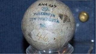 A gutta percha golf ball held at The Royal and Ancient Golf Club