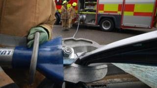 Fire man cutting car