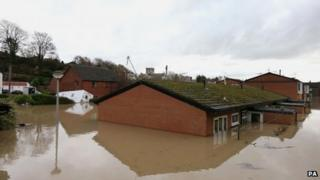 Flood waters come close to covering houses in St Asaph, Denbighshire on Tuesday