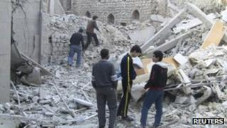 Photo allegedly showing residents looking at destroyed buildings in Homs, Syria. Photo: November 2012