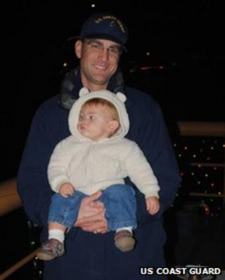 Chief Petty Officer Terrell Horne and child in undated photo provided by US Coast Guard