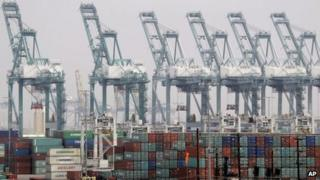 Shipping containers are seen as port operations are halted during a strike at the Port of Los Angeles Tuesday, 4 December 2012
