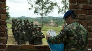 An EU training officer sets up training props for Somali troops at a military academy in Uganda, May 2012