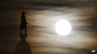 A bronze statue of George Washington by the light of a full moon in Trenton, New Jersey, on 29 November 2012