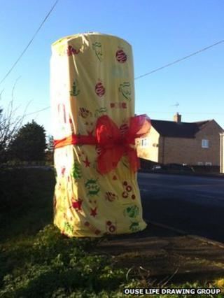Post box wrapped up as a Christmas present in Prickwillow, Cambs