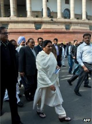Bahujan Samaj Party (BSP) President Mayawati (C) leaves Parliament house during the winter session in New Delhi on December 5, 2012.