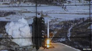 A screen shows the Unha-3 (Milky Way 3) rocket being launched from a launch pad in North Korea released by the official KCNA news agency, 12 December 2012