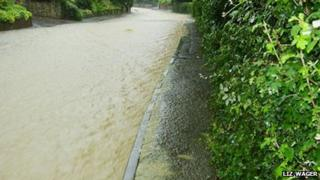 Flooding in Noverton Lane, Prestbury, during summer 2007. Image courtesy Liz Wager
