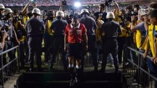 Referee goes to speak with Tigre players during the half time of Copa Sudamericana football final match at Morumbi stadium in Sao Paulo, Brazil, on 12 December 2012