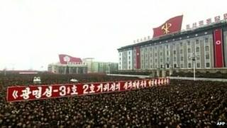 North Koreans attending a mass rally organised to celebrate the success of a rocket launch that sent a satellite into space, Kim Il-sung Square, Pyongyang, North Korea, 14 December 2012
