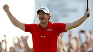 Rory McIlroy celebrates winning the USPGA Championship in August