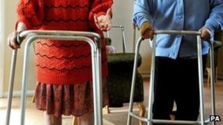 Elderly people with walking frames