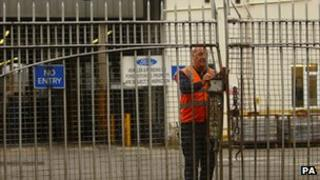 Ford worker closing gates in Southampton