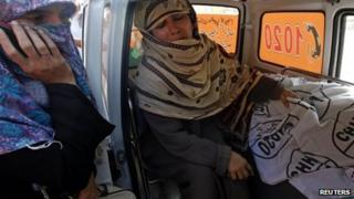 Woman with body of daughter, who worked for anti-polio campaign - 18 December